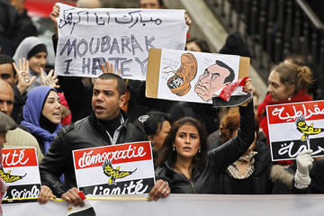 Protesters take part in a demonstration against Egypt's President Hosni Mubarak, in Paris
