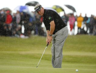 Clarke putts for an eagle on seventh green during final round of British Open golf championship at Royal St George's in Sandwich