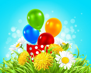 box with balloons in the grass with daisies, dandelions and camomile