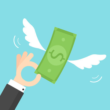Hand holding money with wings