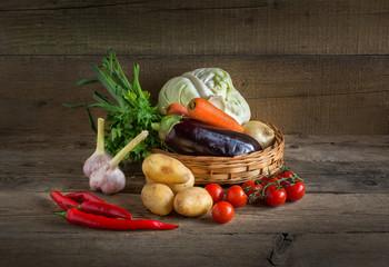 Basket of vegetables on the wood background