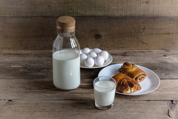 Glass and bottle of milk and biscuits
