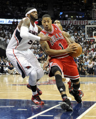 Bulls guard Rose drives around the Hawks Smith in the first half of their Eastern Conference semi-finals NBA basketball game in Atlanta.