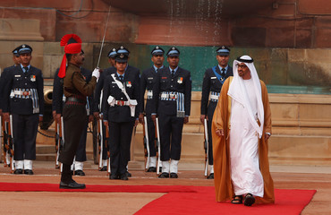 Sheikh Mohammed al-Nahyan Crown Prince of Abu Dhabi inspects a guard of honour during his ceremonial reception at the forecourt of India's Rashtrapati Bhavan presidential palace in New Delhi