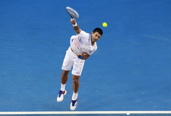 Djokovic of Serbia serves to Murray of Britain during their semi-final match at the Australian Open in Melbourne