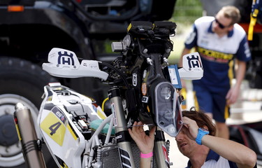 File photo of a mechanic working on a Husqvarna motorcycle in Buenos Aires