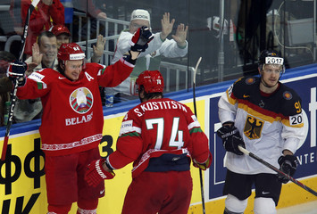 Grabovski of Belarus celebrates his goal with team mate Kostitsyn as Germany's Muller reacts during the third period of their men's ice hockey World Championship Group B game at Minsk Arena in Minsk