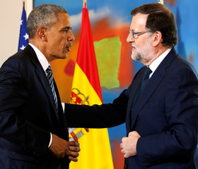 Obama and Rajoy depart after speaking to reporters following their meeting at the Palacio de la Moncloa in Madrid, Spain