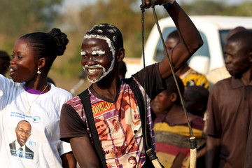 A man with face paint cheers presidential candidate Anicet-Georges Dologuele as he lands during his campaign ahead of Sunday's second round election against Faustin-Archange Touadera, in the town of Bossangoa