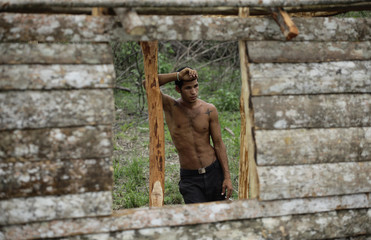 Migrant laborer Osleidis takes a break from building his home on a piece of fallow state-owned land on the outskirts of Havana