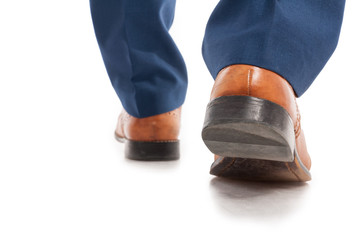 Closeup view of businessman shoes from behind