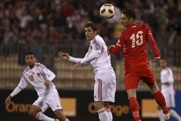 Singapore's Daniel Bennett fights for the ball with Jordan's Ahmad Hayel during their 2014 World Cup qualifying soccer match in Amman