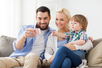 happy family with smartphone at home