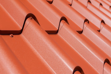 Red metal tile with screw