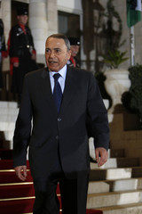 Jordanian Prime Minister Bakhit leave after the swearing-in ceremony at Raghadan Palace in Amman