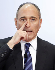 Joseph Jimenez, chief executive of Swiss drugmaker Novartis, touches his nose during the company's annual news conference in Basel