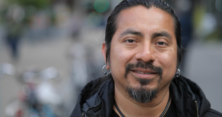 Hispanic Latino man in city face portrait