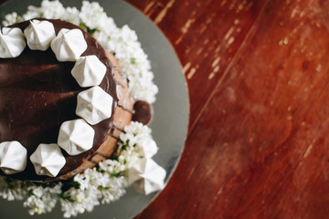 A home made cake covered by chocolate