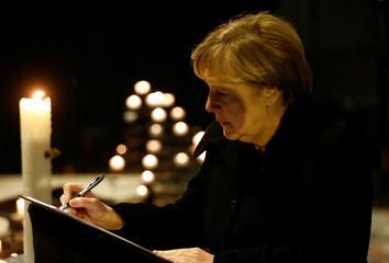 German Chancellor Angela Merkel signs the condolence book at the Gedaechniskirche in Berlin