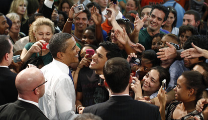 U.S. President Obama greets students after speaking about energy at the University of Miami in Miami