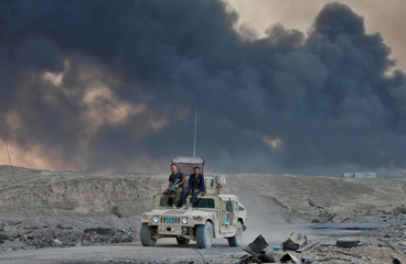 An Iraqi army vehicle is seen during an operation to attack Islamic State militants in Mosul, in Qayyara