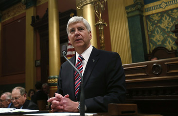 Michigan's Governor Rick Snyder gives his annual State of the State address to the Assembly in Lansing, Michigan