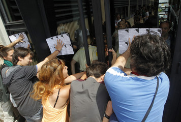 Students, who are protesting against cuts in education, try to storm into the central hall at the Polytechnic University in Valencia