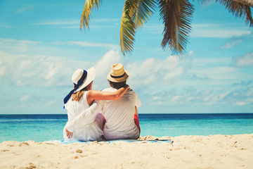 happy loving couple on tropical beach