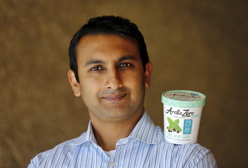 Arctic Zero CEO Pandhi poses for a picture with his company's healthy frozen dessert in San Diego