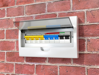 Shield with circuit breakers on a brick wall. 3D illustration