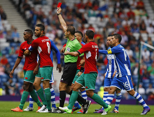Morocco's Zakarya Bergdich (L) receieves a red card from referee Pavel Kralovec during their men's Group D football match against Honduras at the London 2012 Olympic Games at Hampden Park in Glasgow