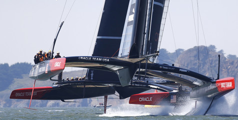 Oracle Team USA AC72 catamarans train near the Golden Gate Bridge on San Francisco Bay