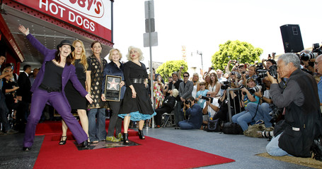 Members of The Go-go's pose as they receive a star on the Walk of Fame in Hollywood