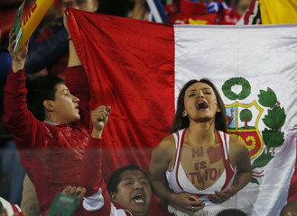 Peru fans await the start of the team's Copa America 2015 semi-final soccer match against Chile at the National Stadium in Santiago