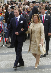 Grand Duke Henri of Luxembourg and his wife Grand Duchess Maria Teresa leave the townhall after the civil wedding service for Luxembourg's Hereditary Grand Duke Guillaume and Countess Stephanie de Lannoy in Luxembourg