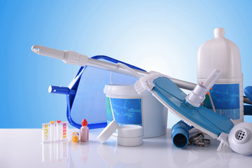 Chemical cleaning products and tools for pool with blue background
