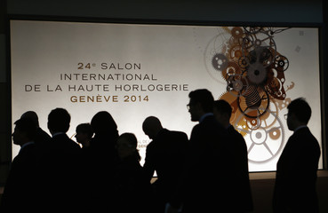 Visitors arrive at the SIHH exhibition at the Palexpo in Geneva