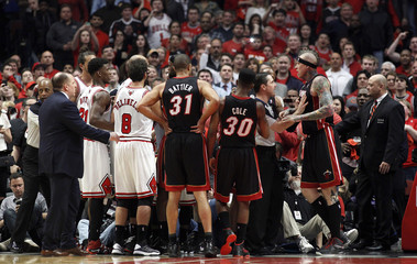 The Chicago Bulls and the Miami Heat have to be separated during Game 3 of their NBA Eastern Conference semi-finals basketball playoff series in Chicago