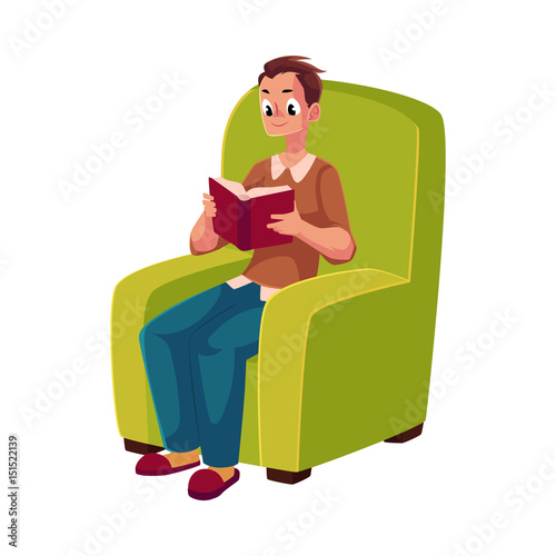 Young Man Boy Reading Book Sitting Comfortably In Armchair