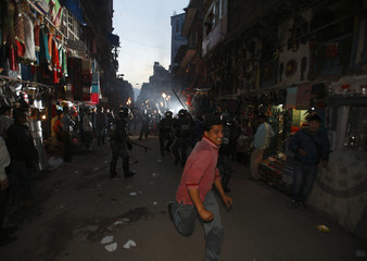 Nepalese police clash with members of Mohan Baidya faction of United Communist Party of Nepal during their torch rally to protest against handover of cantonments to government in Kathmandu