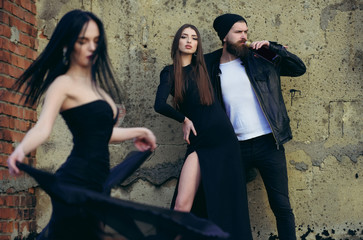 people outdoor, dancing woman in black dress, girl and man