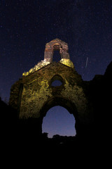 A meteor streaks past stars in the night sky above the ruins of a church in the Los Alcornocales (cork oak forests) nature park, during the Perseid meteor shower in the ancient village of La Sauceda, near Cortes de la Frontera
