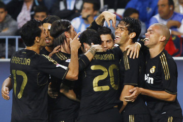 Real Madrid's Ronaldo celebrates with his teammates after scoring his second goal against Malaga during their Spanish First Division soccer match in Malaga