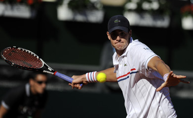 Isner of the U.S. returns a shot to Spain's Almagro during their singles Davis Cup World Group semi-final match in Gijon