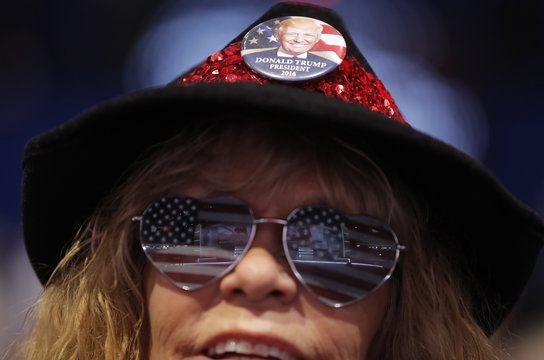 Nevada delegate wears U.S. flag-themed eyeglasses and a Trump button at the Republican National Convention in Cleveland
