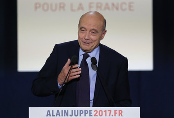 French politician Alain Juppe, current mayor of Bordeaux and member of the conservative Les Republicains political party, attends a rally as he campaigns in the second round for the French center-right presidential primary in Toulouse