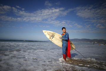 Catello Dannunzio, 12, prepares to compete as Superman during the 7th annual ZJ Boarding House Haunted Heats Halloween surf contest in Santa Monica