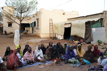 Members of an association for displaced people from the north gather at a house in Bamako