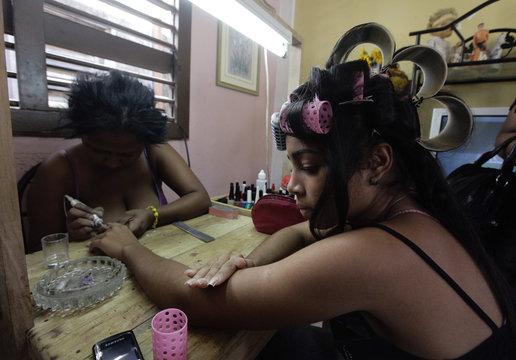 Carmen Gonzalez has her nails manicured before her quinceanera celebration in Havana