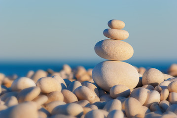 Four pebbles balancing on a beach. Harmony, Teamwork or Meditation